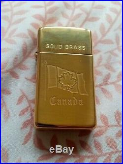 Solid Brass Zippo Canada slimline new very rare still sealed